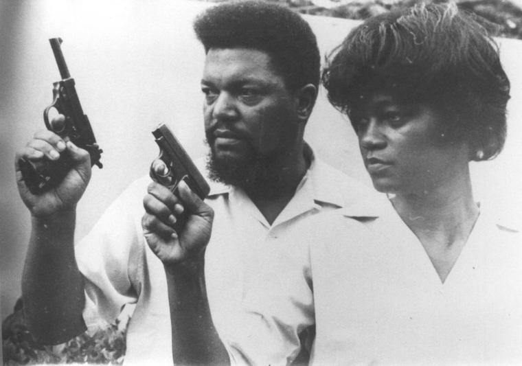 Robert and Mabel Williams with pistols, training in Cuba.