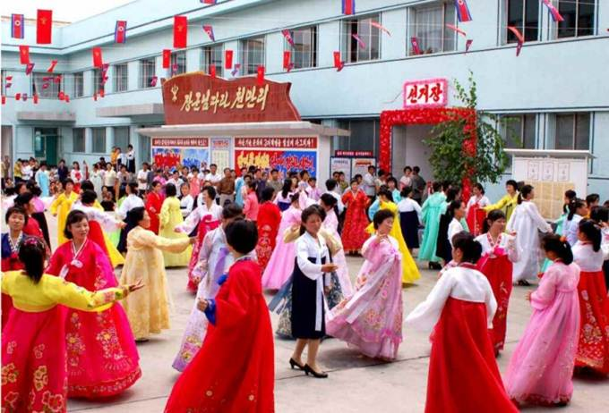 Voters dance near the voting station in Tonghungsan district, Hamhung, South Hamgyong province, on July 19, 2015.
