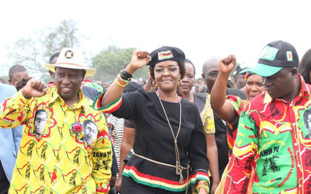 Photograph by Wilson Kakurira showing First Lady and zanu-pf Women's League secretary Dr Grace Mugabe, flanked by Acting Manicaland zanu-pf provincial chairman Cde Samuel Undenge and Minister of State for Manicaland Provincial Affairs Mandi Chimene (partially obscured), salutes the revolutionary party's supporters on arrival for a rally at St John's Primary School in Buhera yesterday.